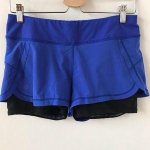 Athleta cobalt blue and black running shorts